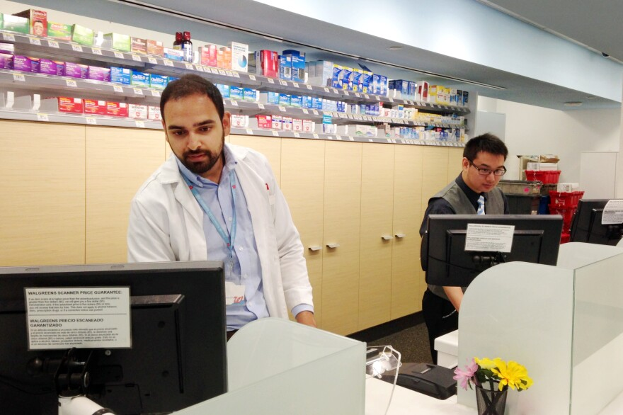Amil Patel (left) and Bob Dunn run the front desk at this Walgreens pharmacy on the campus of the University of California, San Francisco. The store will be one of the first to take advantage of a new California law expanding pharmacists' scope of practice.