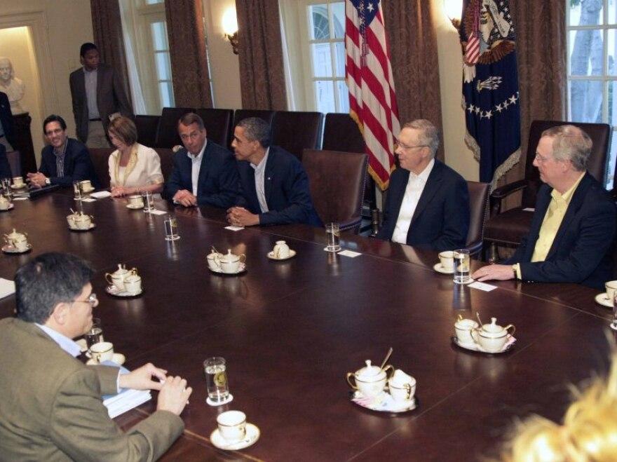 President Barack Obama, House Speaker John Boehner of Ohio, Senate Majority Leader Harry Reid of Nev. and others meet in the Cabinet Room of the White House, Sunday, July 10, 2011, in Washington, to discuss the debt.