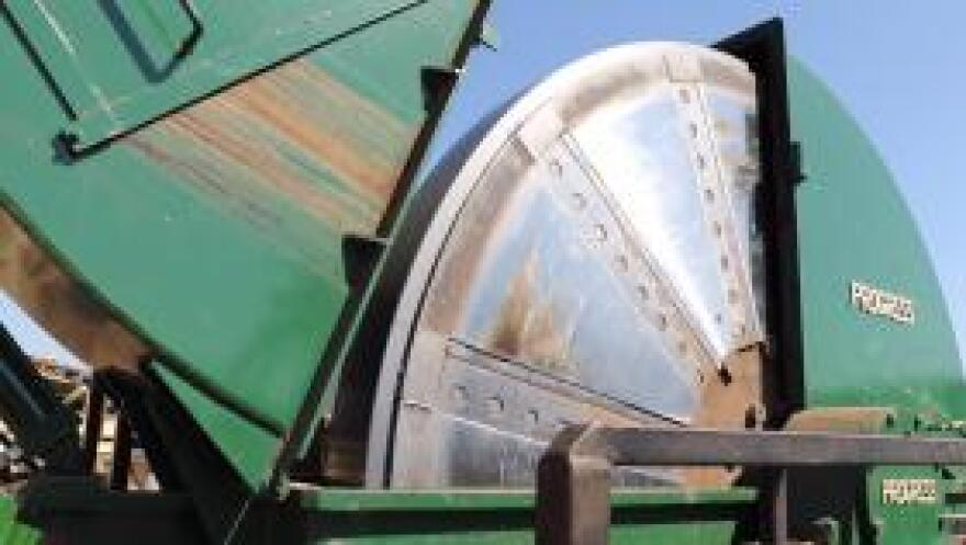 The mill's chipper contains a thick solid-steel circular plate, affixed with heavy blades which reduces whole logs into wood chips within minutes.