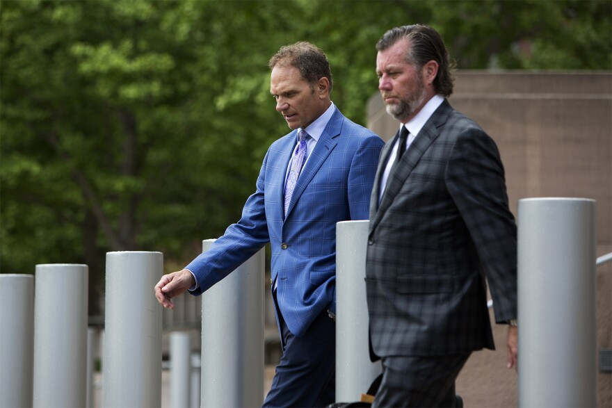 John Rallo (left) walks out of federl court after pleading guilty to federal corruption charges Tuesday