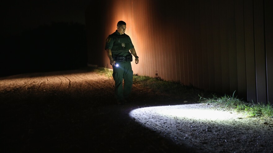 A Border Patrol agent checks for footprints near the U.S. border with Mexico on April 13 in Weslaco, Texas.