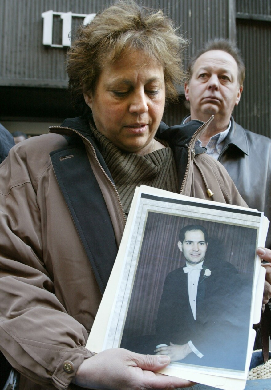 Diane Piagentini, widow of slain police officer Joseph Piagentini, holds a photo of her husband from their wedding day in 1966, after a parole hearing, Friday, Jan. 9, 2004 in New York, to ask that the killers of her husband and his partner not be released on parole. Officers Piagentini and Waverly Jones were killed in 1971 by members of the Black Liberation Army.
