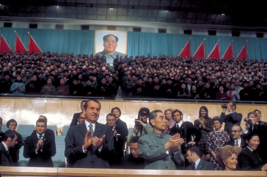 President Richard Nixon and Chinese Premier Chou En Lai watching a pingpong match during Nixon's visit to China, 1972