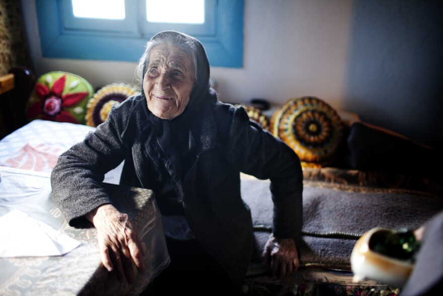 """Efstratia Mavrapidou, 89, at her home in the village of Skala Sikaminias, Lesbos. """"When my mother arrived here in 1922, there were five impoverished farmers here,"""" she says. """"She and her babies slept in sheds where olives were stored."""""""