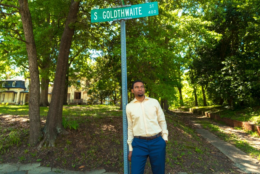 Justin Hampton is executive director of Common Ground Montgomery, a community development organization. He's standing near the site of an old plantation on a street that is seeing renewed investment near the National Memorial for Peace and Justice.