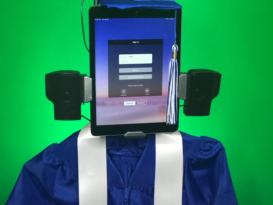 Linda Williams made commencement caps and gowns for the robots of her virtual events planning business to wear during graduation ceremonies not help in person.