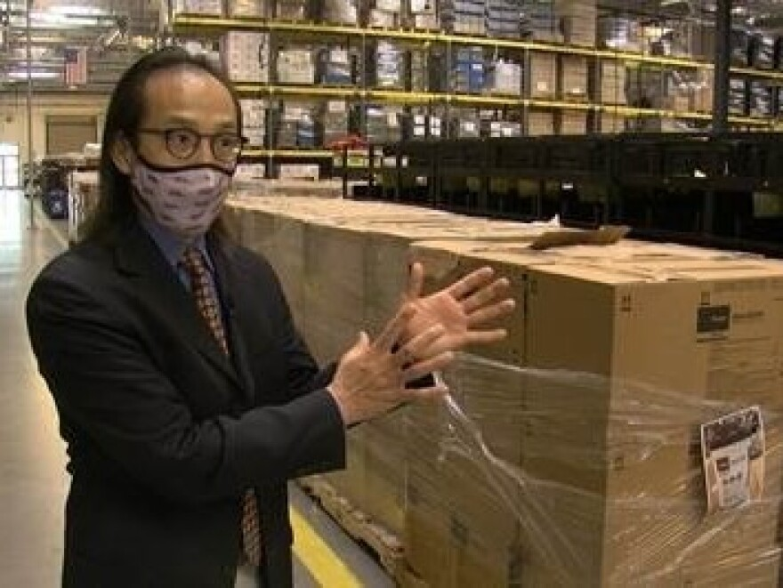 San Diego County Registrar of Voters Michael Vu tours the warehouse where the county keeps its polling place supplies.