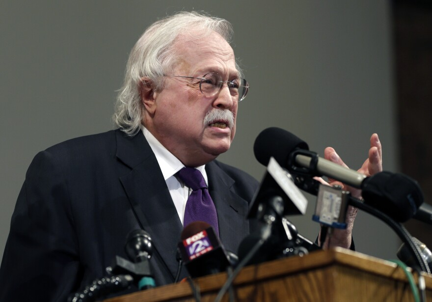 In this Aug. 18, 2014, file photo, pathologist Dr. Michael Baden speaks during a news conference to share preliminary results of a second autopsy done on Michael Brown in St. Louis County, Mo. Baden, a pathologist hired by Jeffrey Epstein's brother.