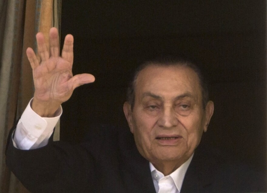Ousted former Egyptian President Hosni Mubarak waves to his supporters last year from his hospital room in Cairo, Egypt.