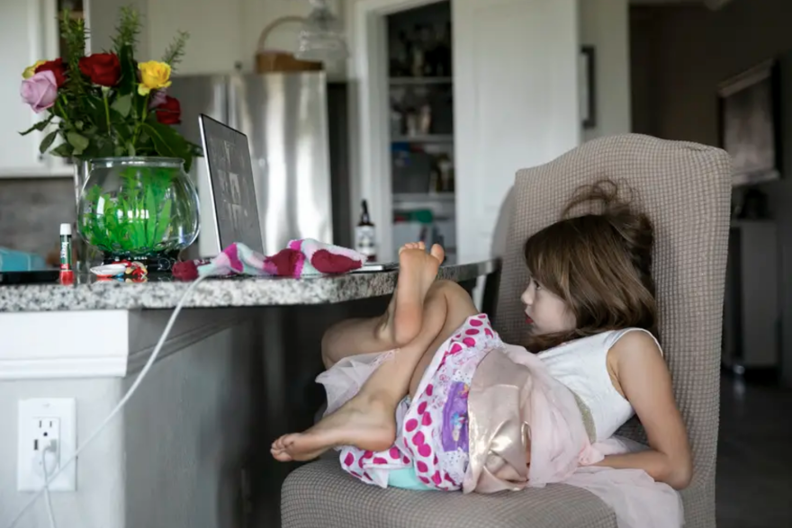 Five-year-old Nora meets with her new kindergarten class virtually in her family's home in Katy on Monday, Aug. 24, 2020.