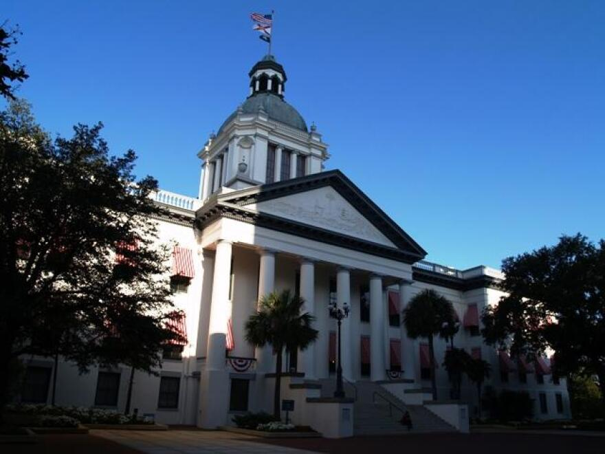 old florida capitol building white with striped awnings
