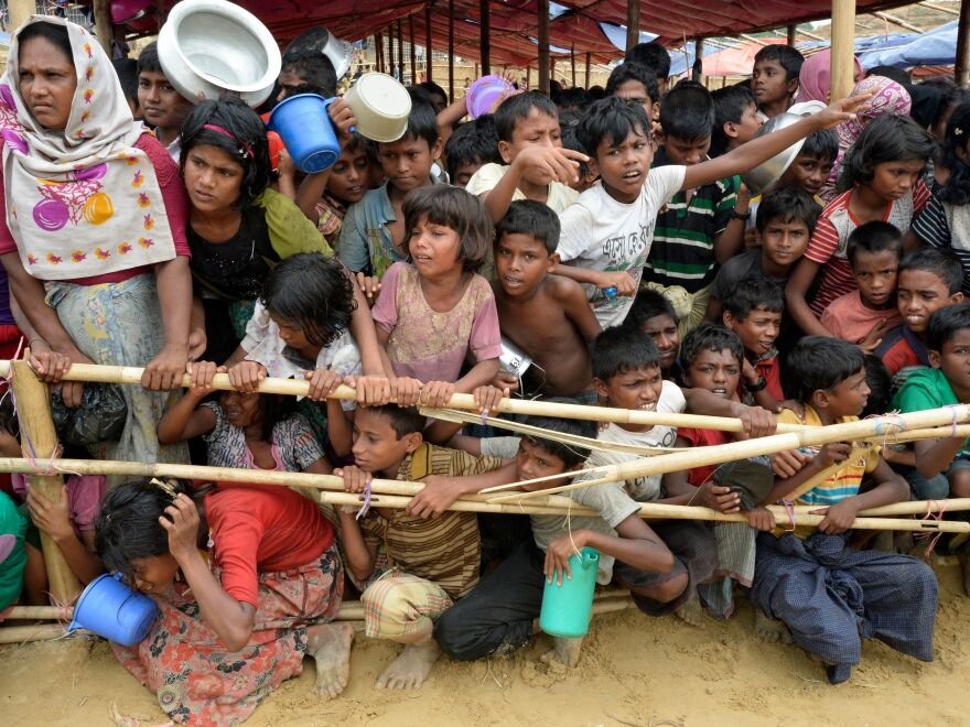 Rohingya Muslim refugees in Bangladesh wait to receive food distributed by a Turkish aid agency at a refugee camp on Saturday.