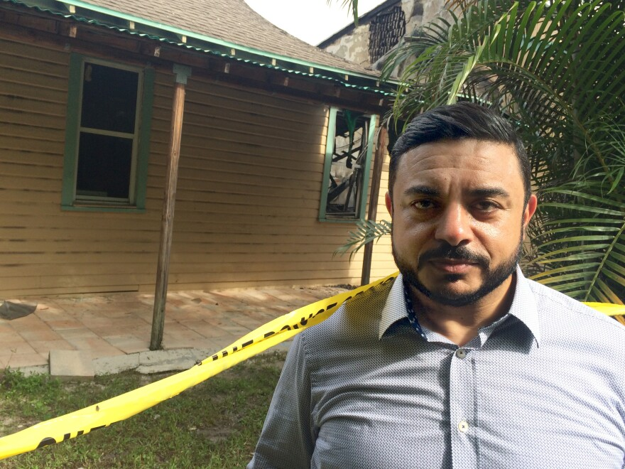 """Ahmed Bedier, a Muslim community activist, stands outside the Fort Pierce mosque, damaged in arson attack this week. He says Clinton's comments were probably """"unwise"""" but """"honest."""""""