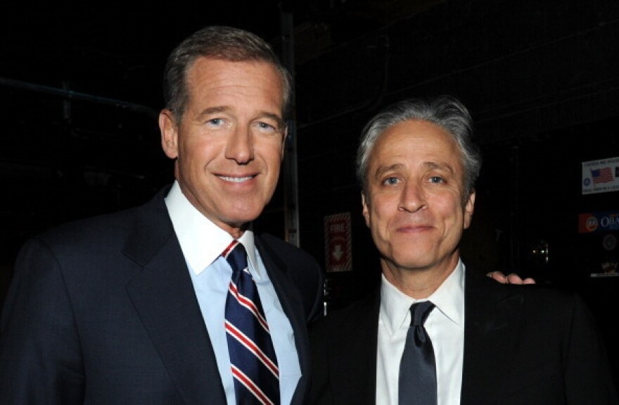 "Brian Williams and Jon Stewart backstage at ""The New York Comedy Festival And The Bob Woodruff Foundation Present: The 7th Annual Stand Up For Heroes"" event at Madison Square Garden in Nov. 2013."