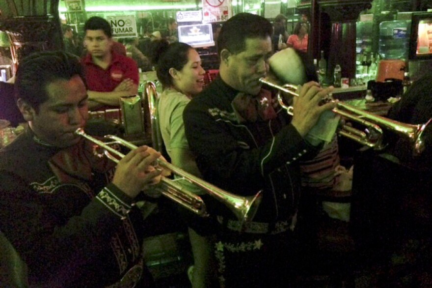 The Mariachi Imperial serenades the crowd at the renowned Kentucky Club in Juarez. Frequented in the past by Marilyn Monroe, Frank Sinatra and a pantheon of Mexican movie stars and boxers, the club managed to stay open during the recent years of violence.