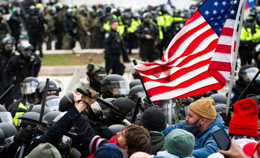 Rioters clash with police outside the Capitol building on Jan. 6.
