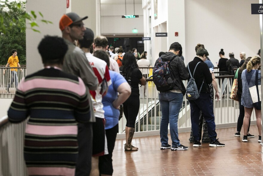 Voters line up to cast ballots in the primaries, at Austin Community College's Highland Campus on March 3.