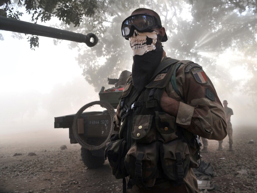This isn't the sort of picture of a French soldier that his commanders want to see. Photographer Issouf Sanogo says troops were protecting their faces from dust kicked up by a helicopter landing in central Mali on Sunday.