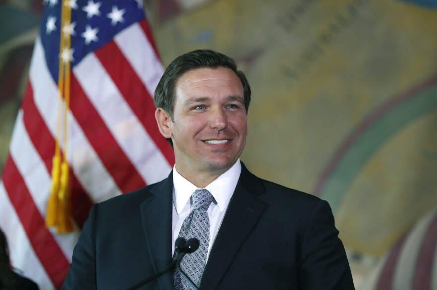 DeSantis speaks at a podium during a press conference
