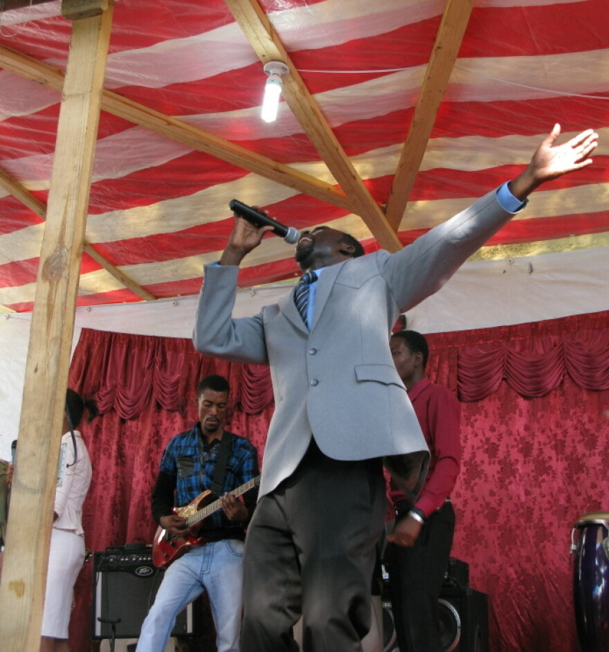 Pastor Junior Antoine on stage at Shalom Tabernacle of Glory evangelical church, in front of a congregation that grew rapidly after the earthquake two years ago.