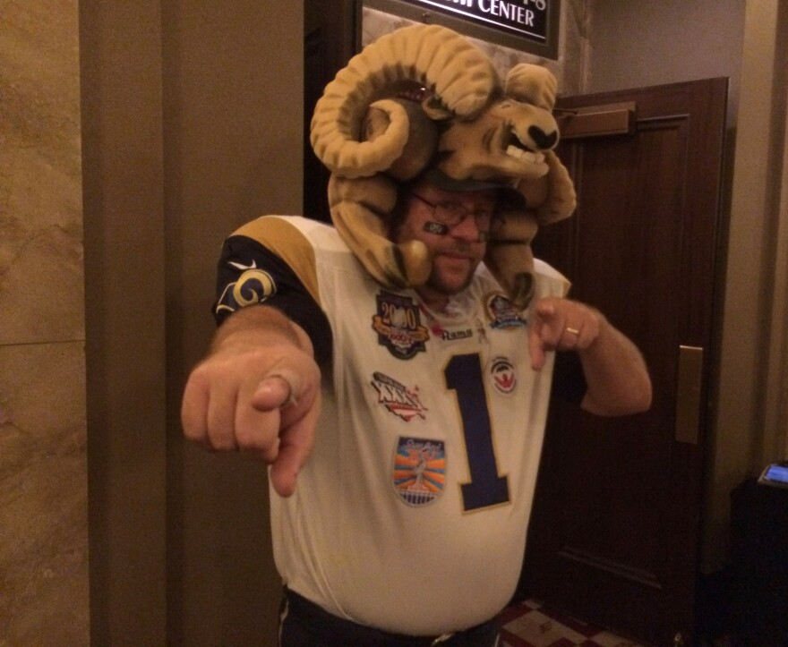 Karl Sides, also known as Ram Man, poses for a reporter a recent public meeting about the St. Louis Rams' future.