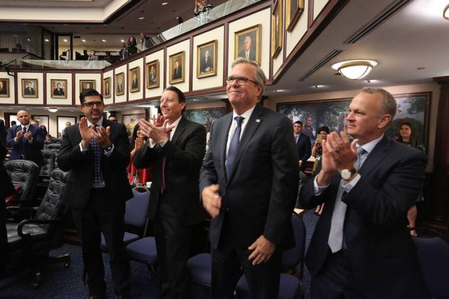From left, Sen. Manny Diaz Jr., R-Hialeah, Senate President Bill Galvano, R-Bradenton, former Gov. Jeb Bush and Education Commissioner Richard Corcoran watch the passage of the school voucher bill in the Florida House on Tuesday, April 30, 2019.