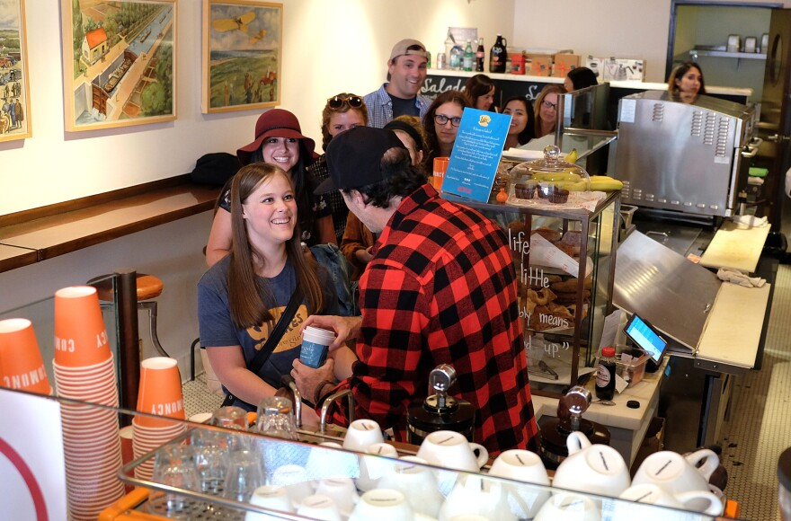 """Actor Scott Patterson hands out coffee at a """"Gilmore Girls"""" themed pop-up of Luke's Diner on Oct. 5th in Beverly Hills, Calif. Pop-ups were scheduled throughout the country."""