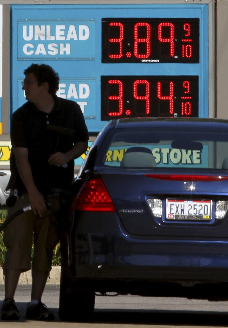 A man fills his gas tank Wednesday in Lyndhurst, Ohio. Gas prices surged as Isaac approached, but are expected to ease after Labor Day.