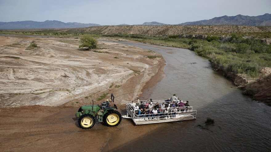 Supporters of rancher Cliven Bundy ride behind a tractor April 10 in Bunkerville, Nev.