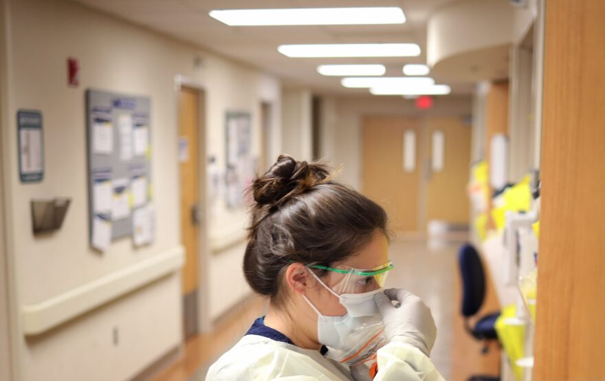 Nurses in the intensive care unit of MedStar St. Mary's Hospital check the fit of protective equipment before entering a patient's room March 24, 2020 in Leonardtown, Maryland. (Win McNamee/Getty Images)