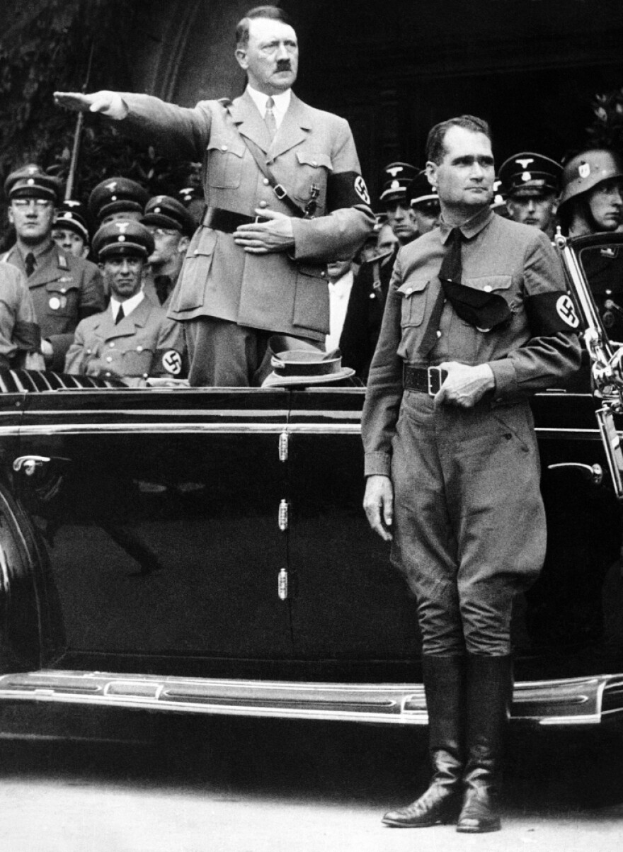 Dec. 30 1938: Adolf Hitler and Rudolf Hess (right) during a parade in Berlin.