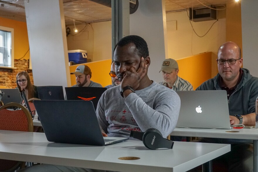 Daniel Agbaji (front) and other Claim Academy students study Java at the start of an all-day boot camp class session. May 9, 2019.