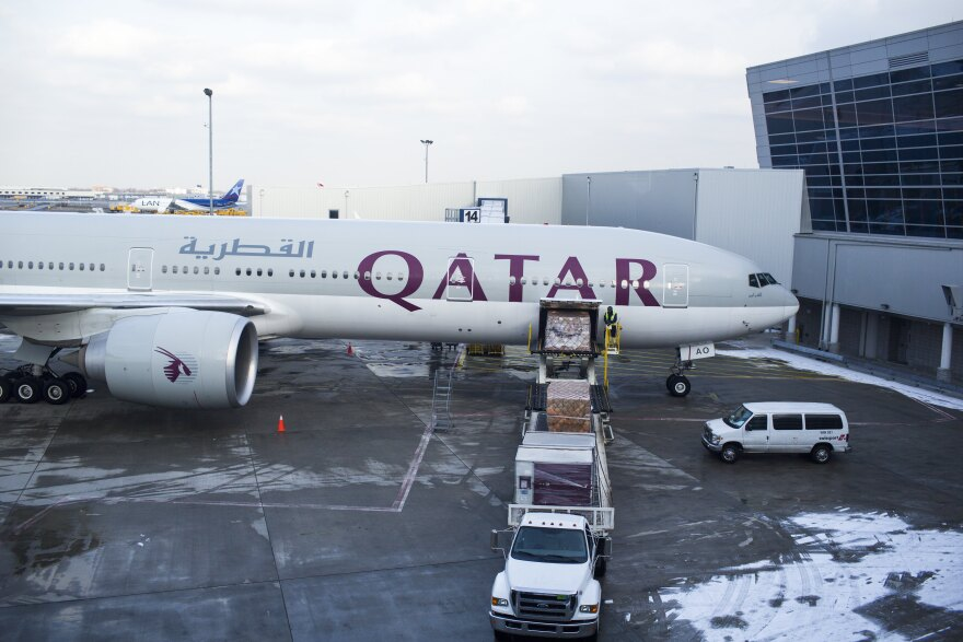 "A Qatar Airways plane loads cargo on Feb. 3, 2013, at  John F. Kennedy International Airport in New York. The big three U.S. airlines — Delta, United and American — say Persian Gulf carriers like Qatar Airways, Emirates Airlines and Etihad are ""dumping"" seats in the U.S."