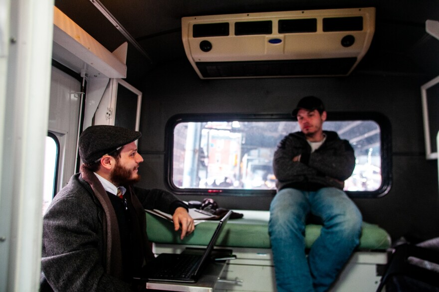 """Inside the exam room on the """"bupe bus,"""" as the mobile medical clinic is called, Dr. Ben Cocchiaro and Louis Morano talk over Morano's options. Morano says he's committed to his recovery this time and wants the support of buprenorphine to help him quit heroin."""