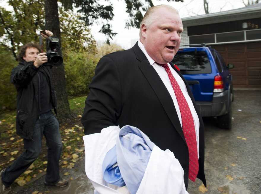 Toronto Mayor Rob Ford told members of the media to get off his property as he left his home in Toronto on Oct. 31.
