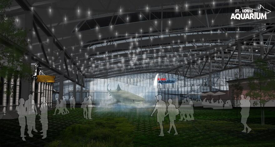 In a nighttime exterior view of the St. Louis Aquarium, the Train Park at Union Station will feature concessions and retail.