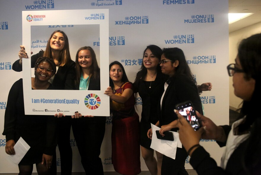 A lighter moment on a serious day: the presentation of a Global Girls' Bill of Rights at the U.N. Left to right: Six of the young women who helped draft the document: Faith Nwando, 17; Djellza Pulatani, 17; Olivia Lombardo, 16; Angelica Morales, 21; Kanchan Amatya, 22; and Vishakha Agrawal, 20.