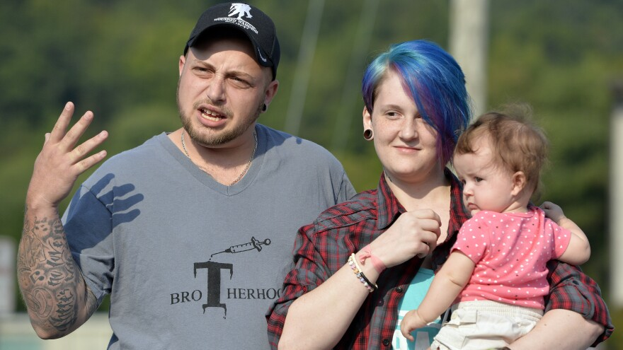 Camryn Colen, his wife, Lexie, and their daughter, LaKoda, attended a same-sex-marriage rally at the Rowan County Courthouse in Morehead, Ky., Saturday. Camryn, who underwent gender reassignment surgery in 2013, married Lexie in February with a marriage license signed by Rowan County Clerk Kim Davis. Since late July, Davis has refused to issue marriage licenses to anyone.