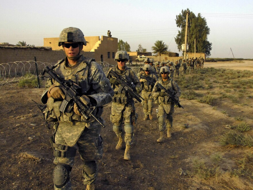 U.S. Army soldiers from 1st Platoon, G Troop, Task Force 1-35, 2nd Brigade Combat Team, move out on patrol in Iraq in 2008. A bipartisan panel says a Pentagon plan to cut Army strength go too far.