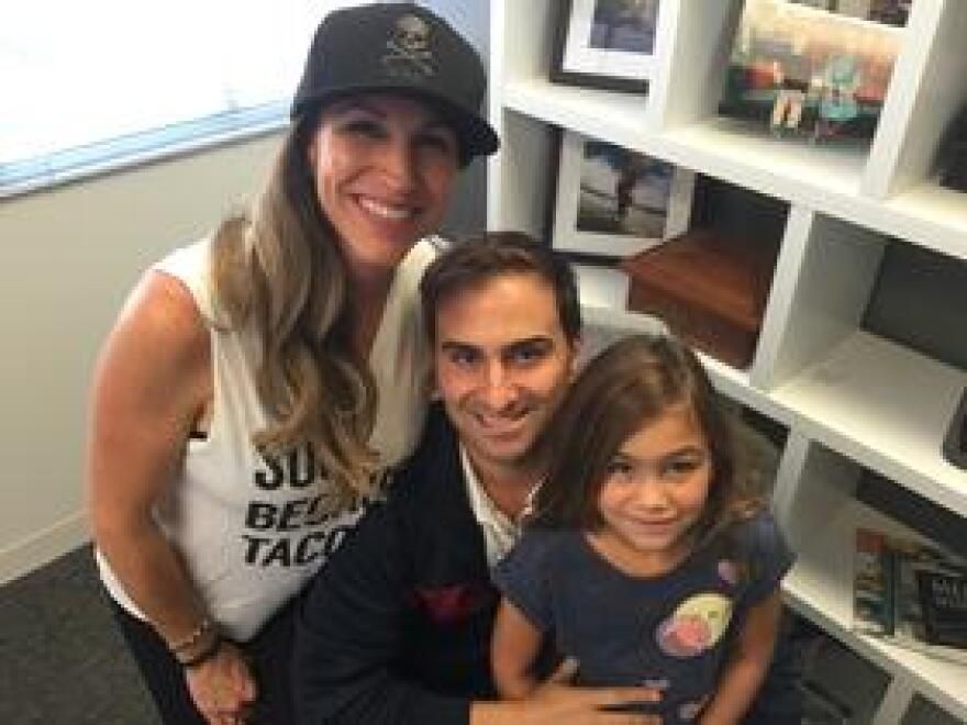Luis Gazitua (center) and his wife Sara Pozo-Gazitua and their daughter Cara Isabella at his Coral Gables law office after Irma.