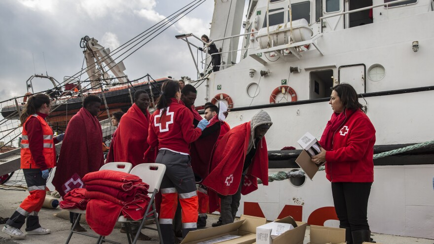Migrants disembark in a port in southern Spain, after being rescued by a Spanish nongovernmental organization's rescue vessel in December. Spain saw an influx of migrants last year, as total migration across the Mediterranean fell.