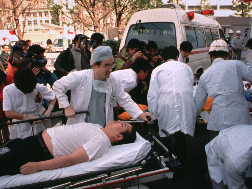 People affected by sarin nerve gas in the central Tokyo subway trains are carried into St. Luke's International Hospital in Tokyo on March 20, 1995.