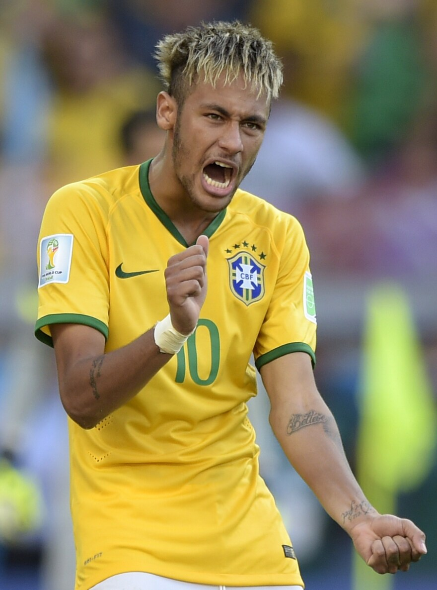 Brazil's forward Neymar celebrates after scoring during the penalty shootout after extra time in the Round of 16 football match between Brazil and Chile at the Mineirao Stadium in Belo Horizonte on Saturday.