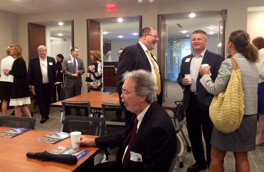 Regional stakeholders and Citizens for Modern Transit members converse over breakfast before a presentation on funding the expansion of mass transit in St. Louis on Thursday, July 23, 2015.
