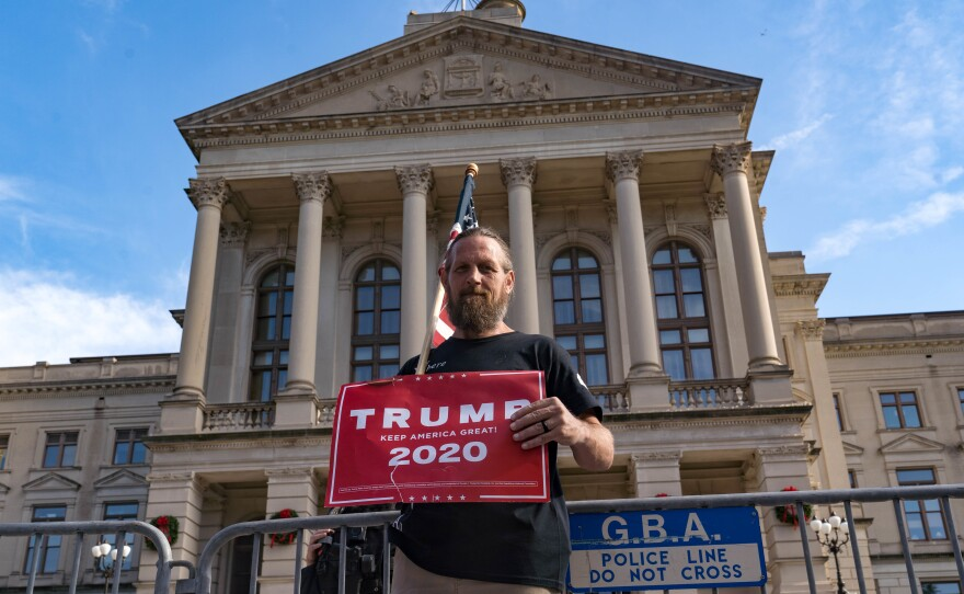A supporter of President Trump protests outside the Georgia State Capitol on Saturday in Atlanta. The president's campaign has requested a vote recount in the state.
