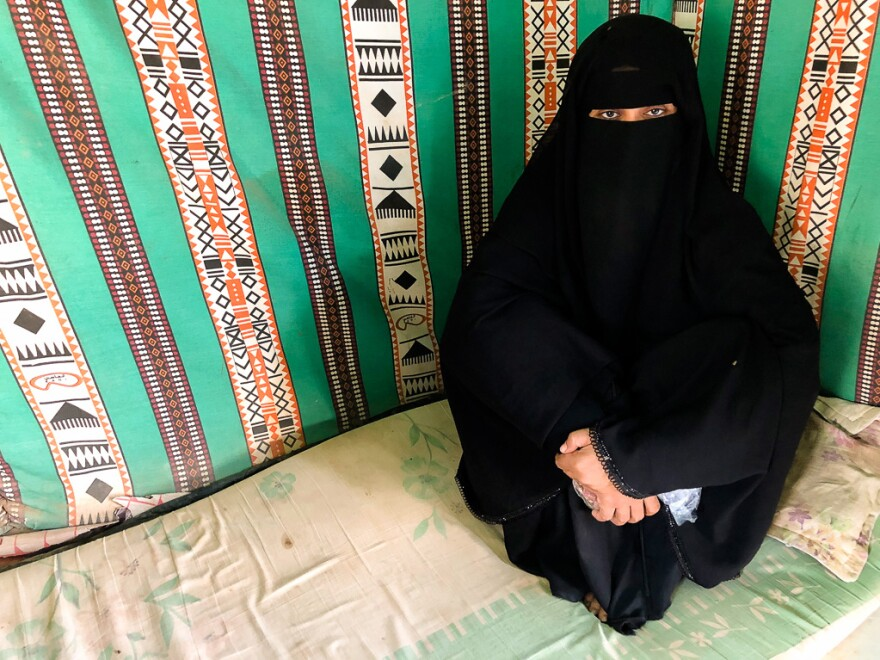 Ola Ali Salim's husband vanished five months ago and is presumed dead. She fled Yemen by boat and now lives with her daughter at a refugee camp in Obock, Djibouti.