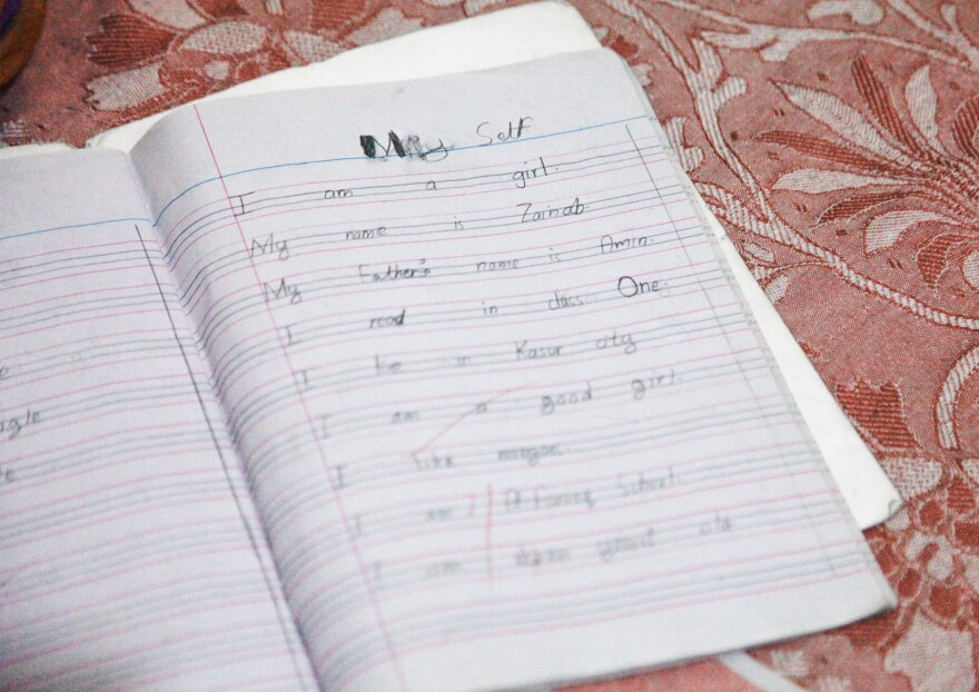"""Zainab's last entry in her English class notebook reads, in part: """"My name is Zainab ... I live in Kasur city. I am a good girl."""""""