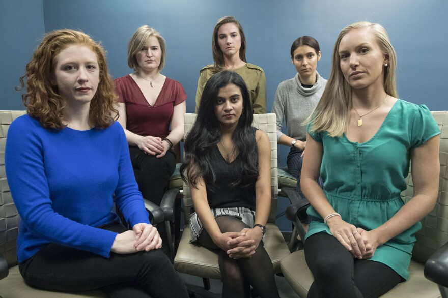 In this Wednesday, Nov. 14, 2018 photo from left back row, Annemarie Brown, Andrea Courtney, and Marissa Evansin, and from left front row, Sasha Brietzke, Vassiki Chauhan, Kristina Rapuano, pose in New York. The women filed a lawsuit against Dartmouth College for allegedly allowing three professors to create a culture in their department that encouraged drunken parties and subjected female graduate students to harassment, groping and sexual assault. (AP Photo/Mary Altaffer)