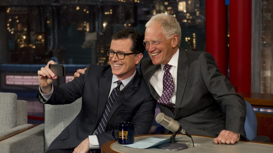 David Letterman, seen here snapping a selfie with his replacement Stephen Colbert, will step down next week as host of the <em>Late Show.</em>