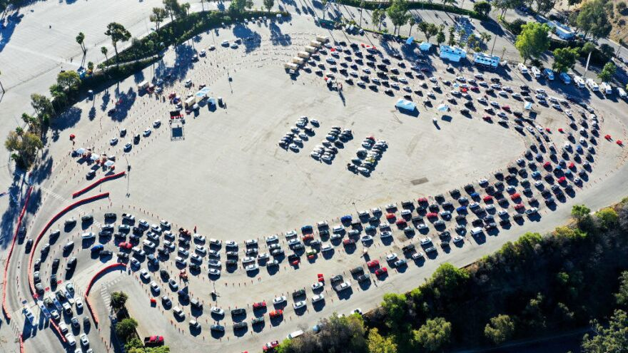 Cars are lined up at Dodger Stadium in Los Angeles for coronavirus testing on November 30, 2020. Nearly 2 million people are currently getting tested a day in the U.S.